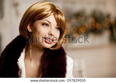 Beautiful adult woman in  winter coat with fur. Trendy modern blondy girl with short hair