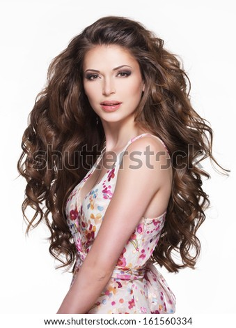 Beautiful adult woman with long brown curly hair. Fashion model over white background - stock photo