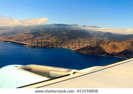 Beautiful aerial view from the plane before landing over Funchal city on Madeira island, Portugal - stock photo