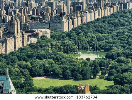Beautiful aerial view of Central park with skyscrapers on a sunny day - New York City. - stock photo
