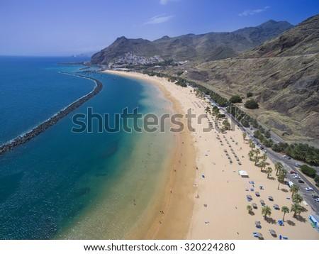 Beautiful aerial view of famous white beach and ocean lagoon Playa de las Teresitas, Tenerife, Canary islands, Spain - stock photo