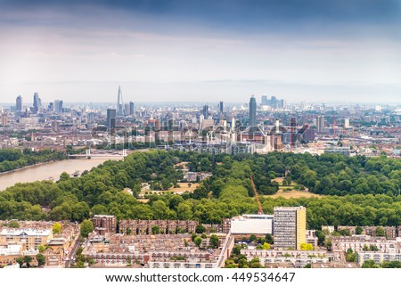 Beautiful aerial view of London with buildings and trees.