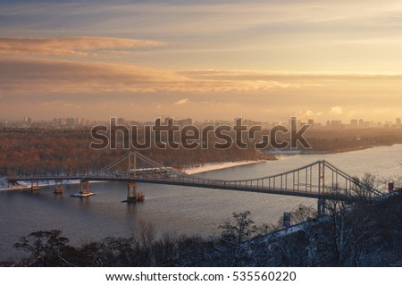 Beautiful aerial view of the Dnieper River and Park Footbridge, Kiyv, Ukraine. Winter morning scenery.