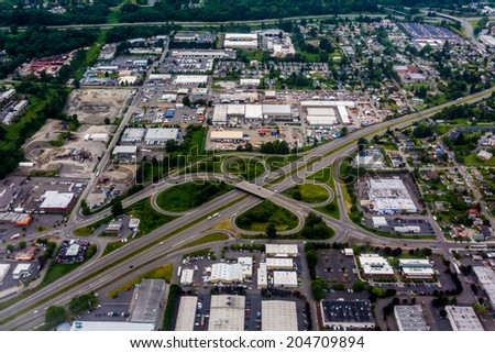Beautiful Aerial View of the Pacific Northwestern City of Seattle, Washington, USA.  Clover-leaf on Freeway. - stock photo