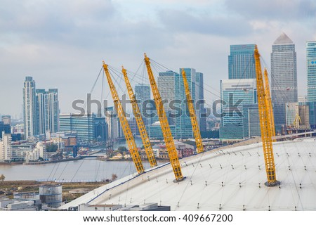 Beautiful aerial view on the O2 dome arena in London with Canary Wharf on the background - stock photo
