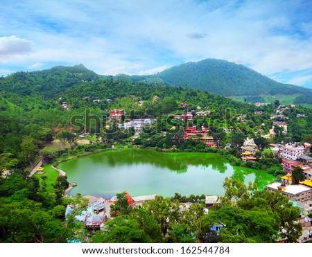 Beautiful aerial view - serene lake Tsopema in Rewalsar (Trisangam) - sacred city for three major Dharma religions - Hinduism, Buddhism and Sikhism, Mandi district, Himachal Pradesh, Northern India - stock photo
