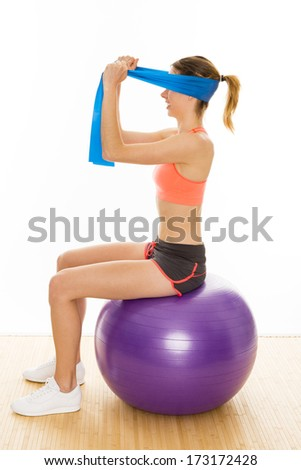 beautiful aerobic trainer is showing gymnastic exercises with a  - stock photo