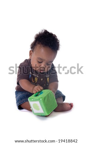 Beautiful African american baby boy playing with a toy on white background - stock photo