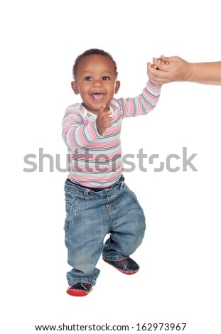 Beautiful African American baby learning to walk isolated on a white background