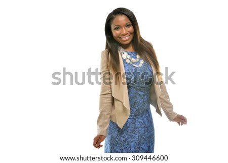 Beautiful African-American business  woman in blue dress and tan blazer in studio - smiling and happy  - stock photo