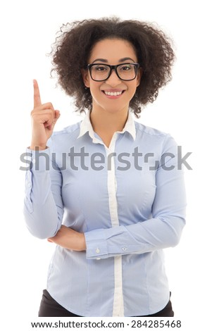 beautiful african american business woman pointing at something interesting against white background - stock photo