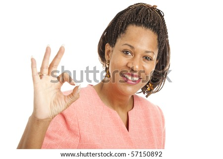 Beautiful African-American businesswoman giving the okay sign.