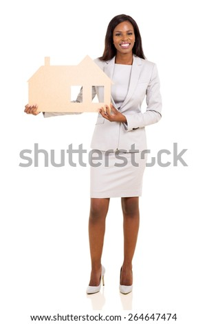 beautiful african american businesswoman holding paper house on white background - stock photo