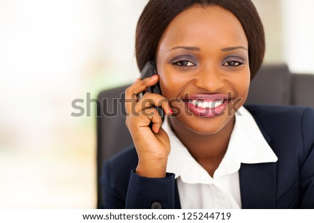 beautiful african american businesswoman talking on mobile phone