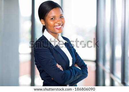 beautiful african american businesswoman with arms folded - stock photo