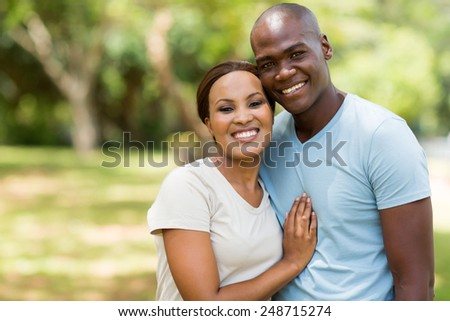 beautiful african american couple outdoors - stock photo
