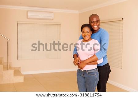 beautiful african american couple standing indoors - stock photo