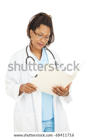 Beautiful african-american doctor reading a patient's medical chart.  Isolated on white. - stock photo