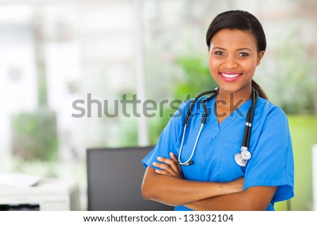 beautiful african american female pediatric nurse in modern office - stock photo