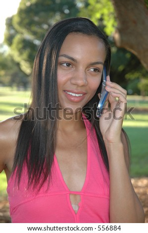 Beautiful African American female talking on the cell