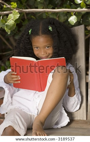 Beautiful African American girl reading