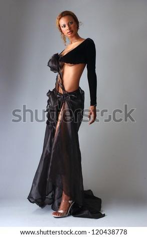 Beautiful African American model posing wearing wool glows - stock photo