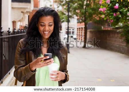 beautiful african american woman checking her messages.  - stock photo