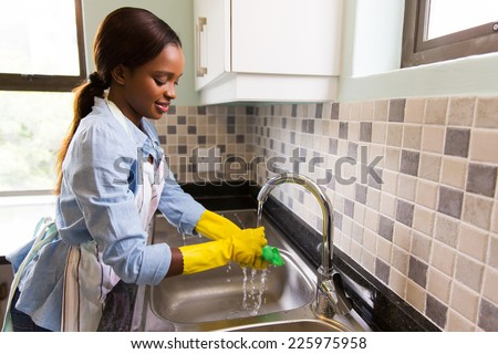 beautiful african american woman doing house chores - stock photo