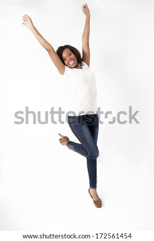Beautiful African American Woman excited with her hands in the air hear good news - stock photo