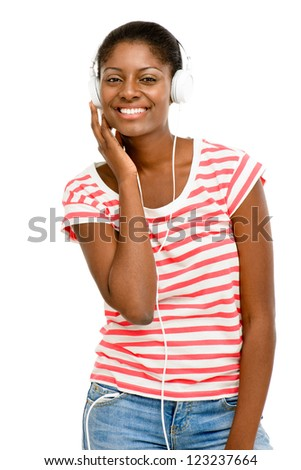 Beautiful African American Woman listening to music mobile phone isolated on white background - stock photo