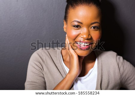 beautiful african american woman looking at the camera - stock photo