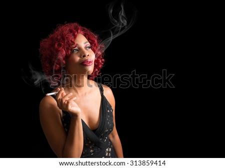 Beautiful african american woman smoking cigarette - stock photo