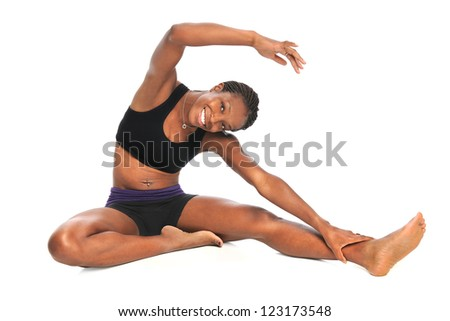 Beautiful African American woman stretching isolated over white background