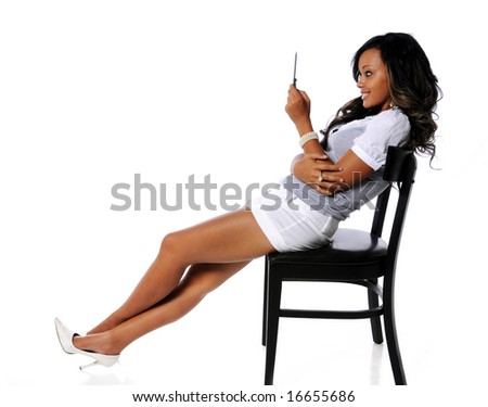 Beautiful African American woman using cell phone