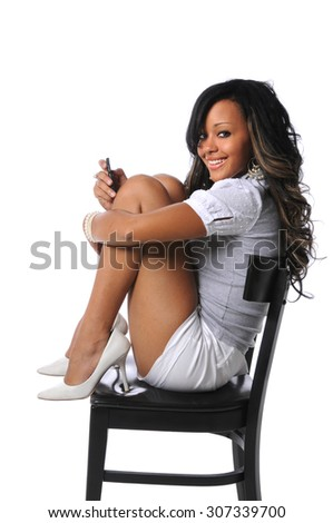 Beautiful African American woman using cellphone isolated over white background