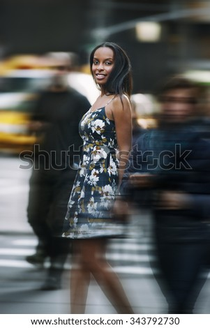 Beautiful african american woman walking on New York City street - stock photo