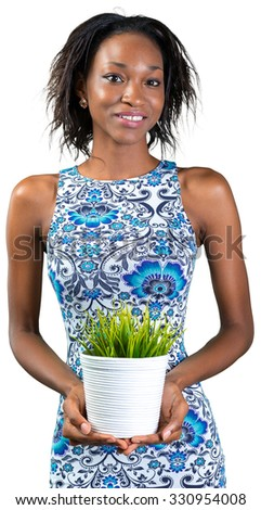 Beautiful african american woman with a flower