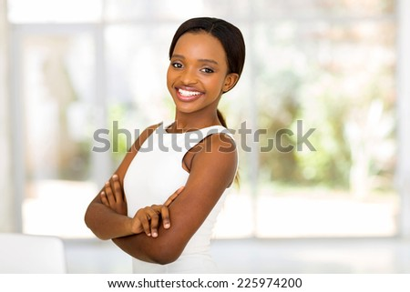 beautiful african american woman with arms crossed - stock photo