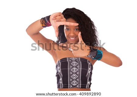 Beautiful African American woman with curly hairs making frame gesture - stock photo
