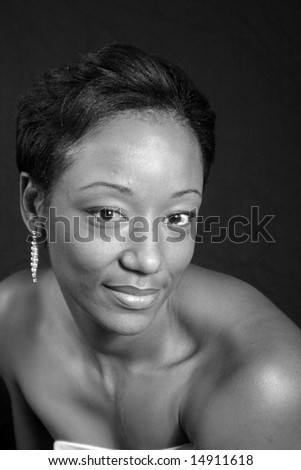 Beautiful African American woman with eye contact in black and white - stock photo
