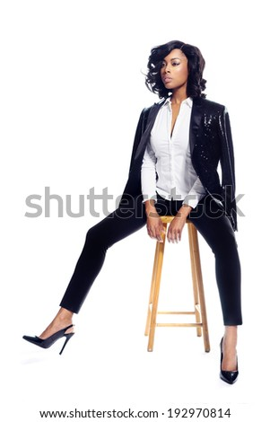 Beautiful African American young woman on white fashionable elegant - stock photo