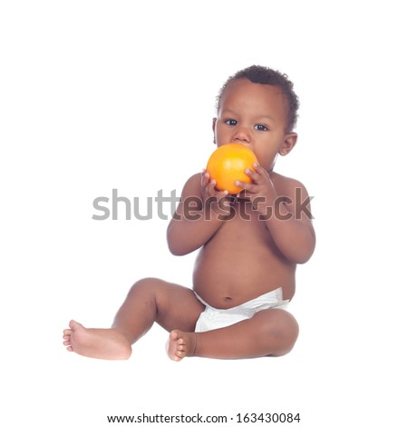Beautiful african baby diapers with a orange isolated on a white background - stock photo