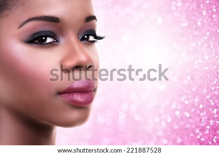 Beautiful African black woman wearing holiday makeup with copy space. Make up. - stock photo