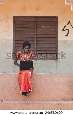 Beautiful African Business Adult Woman Working On Projects On Laptop - stock photo