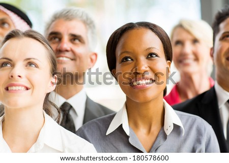 beautiful african businesswoman with colleagues looking up  - stock photo