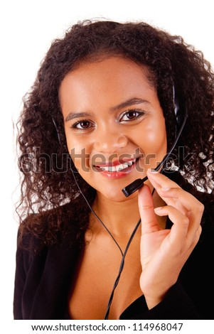 Beautiful african call center woman at work smiling with headset