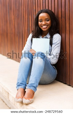 beautiful african college girl portrait on campus - stock photo