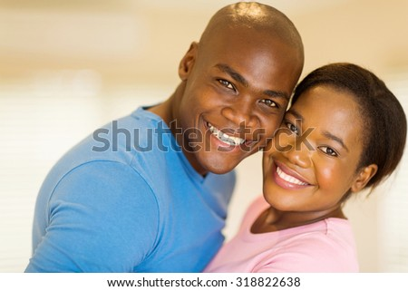 beautiful african couple looking at the camera - stock photo
