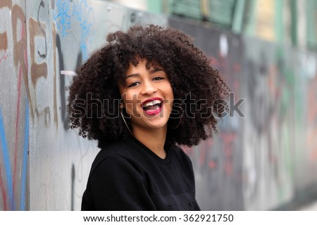 Beautiful African girl laughing - stock photo