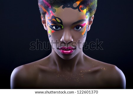 Beautiful african lady with neon make up - stock photo